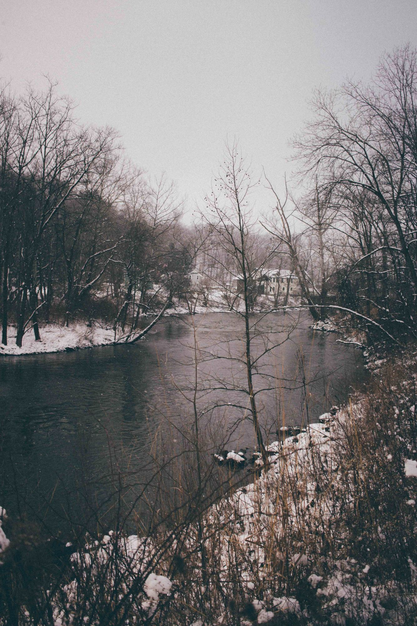 River in the winter with snowfall